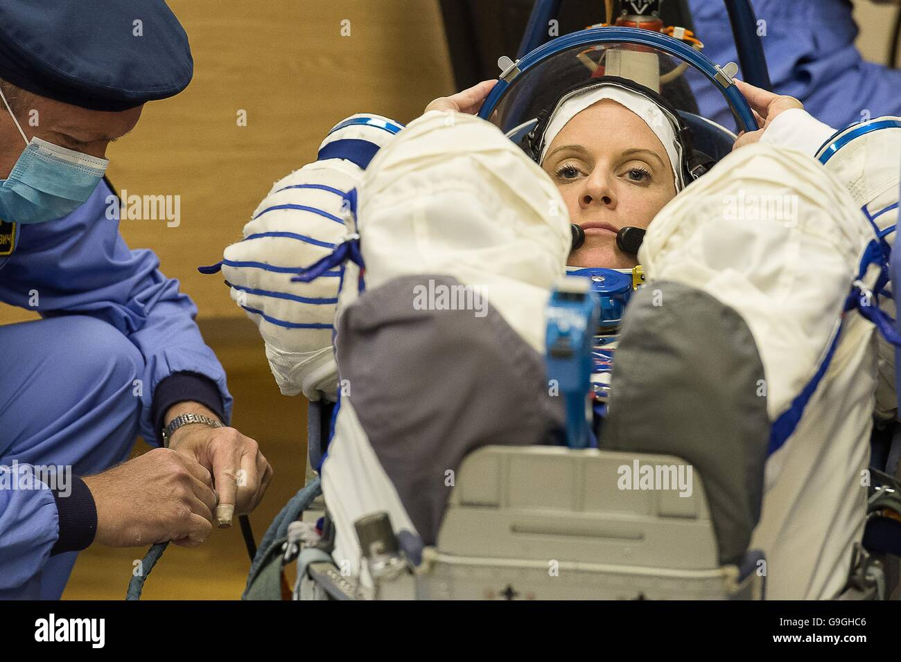 International Space Station Expedition 48 American astronaut Kate Rubins during a leak check of her Russian Sokol - Stock Image