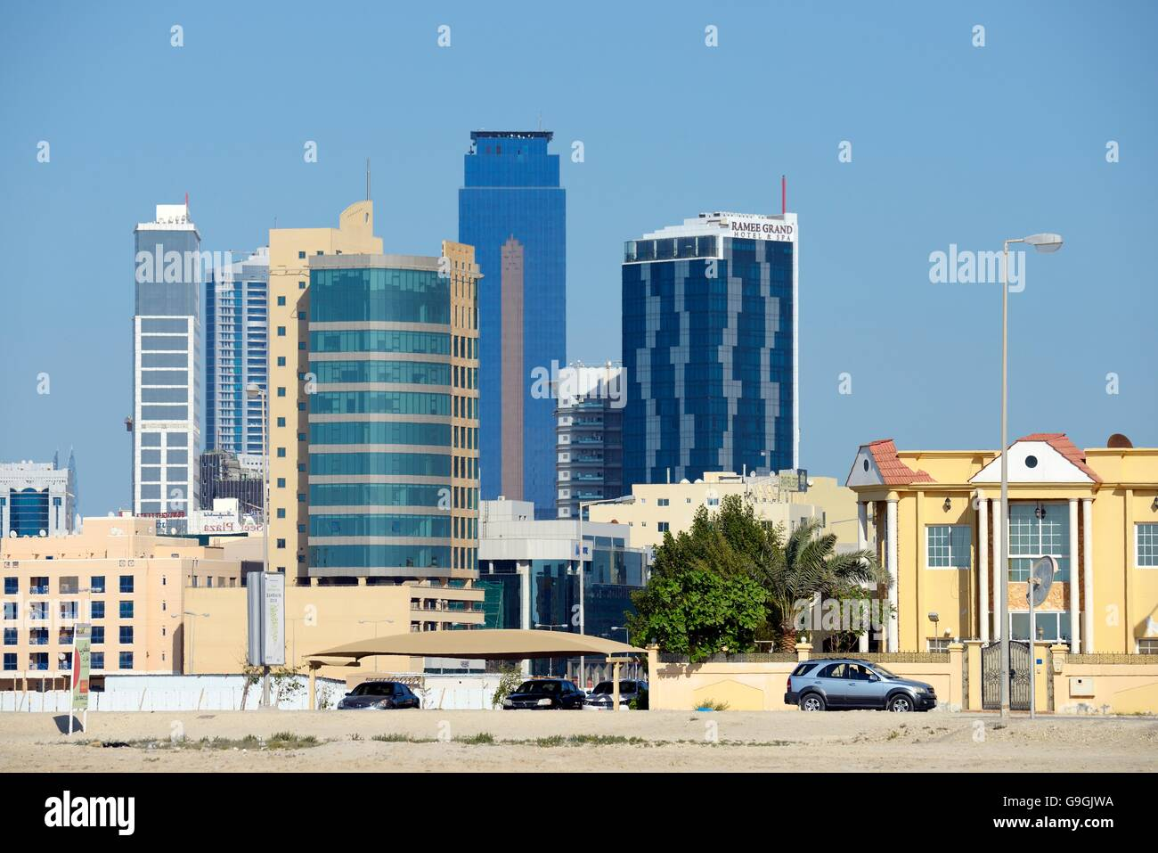 Manama, Bahrain. Seef district. Looking east to the Ramee Grand Hotel and the Almoayyed Tower aka the Dark Tower - Stock Image
