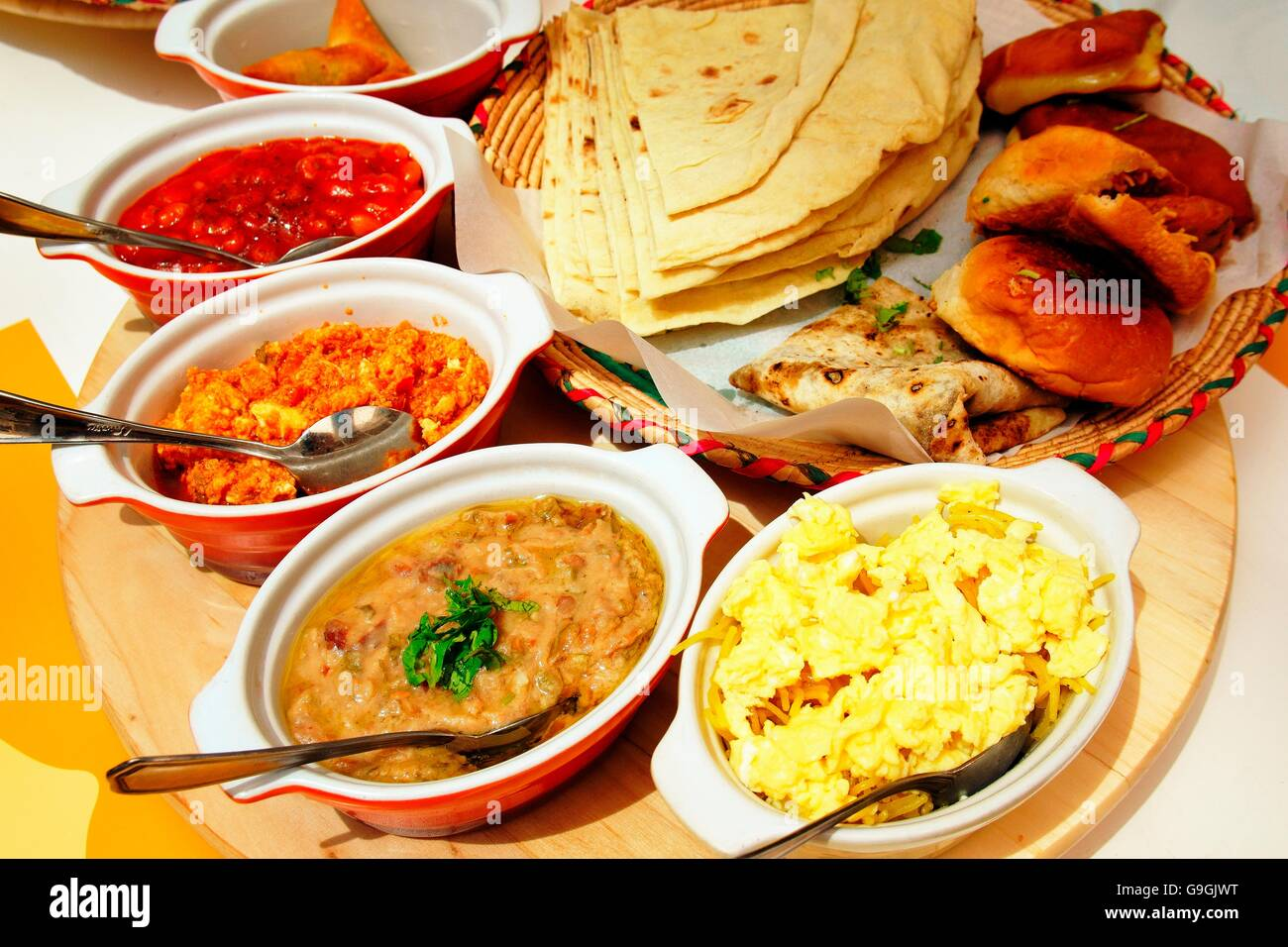 Balaleet, Harees and Margoog traditional Persian Gulf Arabic cuisine dishes served in café in the Manama Souk, - Stock Image