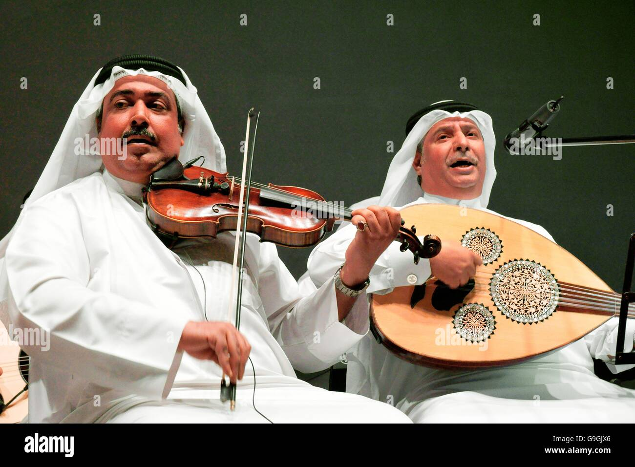 Musicians of the Mohammed bin Faris Ensemble Band play traditional sawt music in Al Khalifa Centre in Muhurraq district, Stock Photo