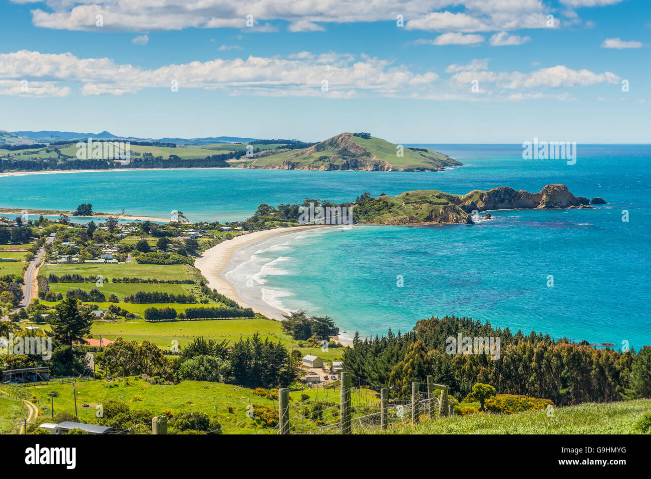 Karitane coastline, Huriawa Peninsula in the center (Historic Maori Pa Site), Karitane near Dunedin New Zealand Stock Photo