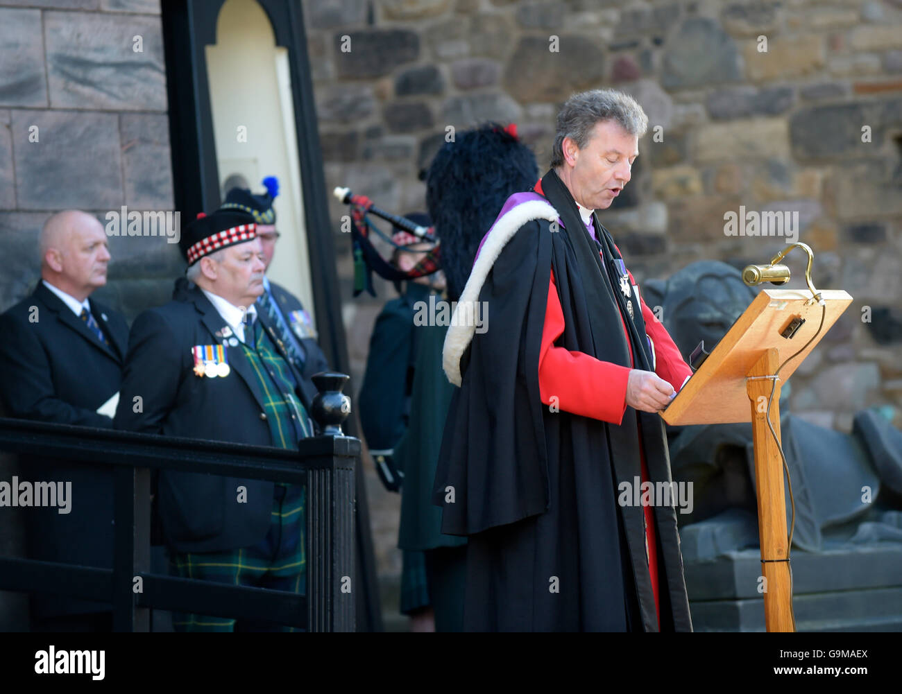 Reverend Neil Gardner of Cannongate Kirk speaks during a special service which followed an overnight vigil, at Edinburgh Stock Photo