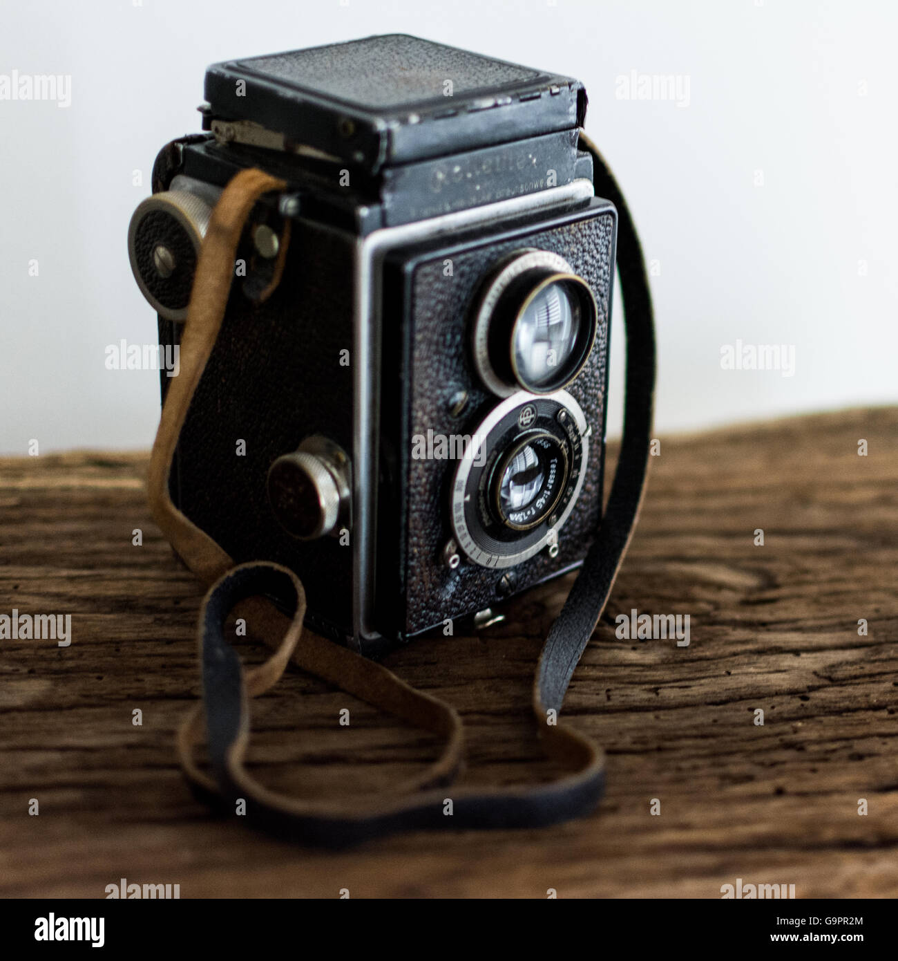 Old camera, Rolleiflex, with two lenses on old wooden shelf Stock Photo