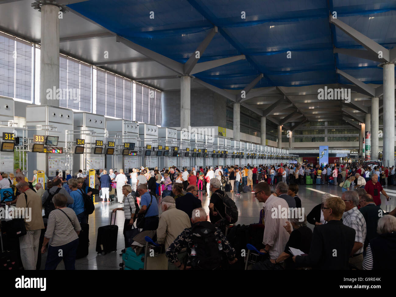 Malaga, Costa del Sol, Malaga Province, Andalusia, southern Spain.  Check-in queues in the airport. - Stock Image