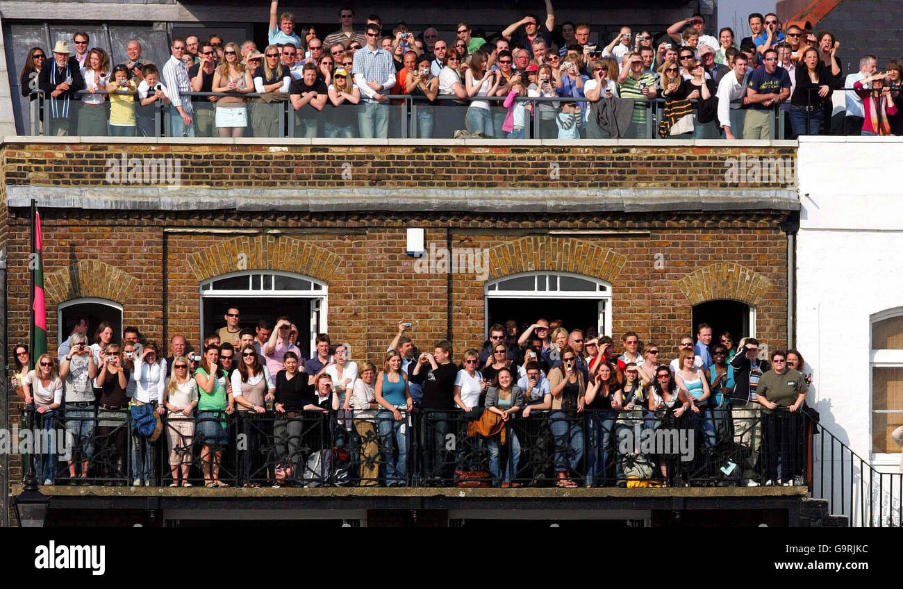 Supporters cheer on the Oxford and Cambridge University rowing teams at Hammersmith during the 153rd Boat Race today. Stock Photo