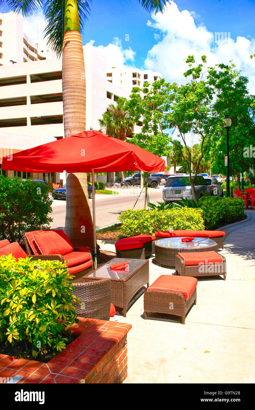 Sidewalk sofas and tables outside Classico Restaurant on the corner of Main and Palm in downtown Sarasota, FL - Stock Image