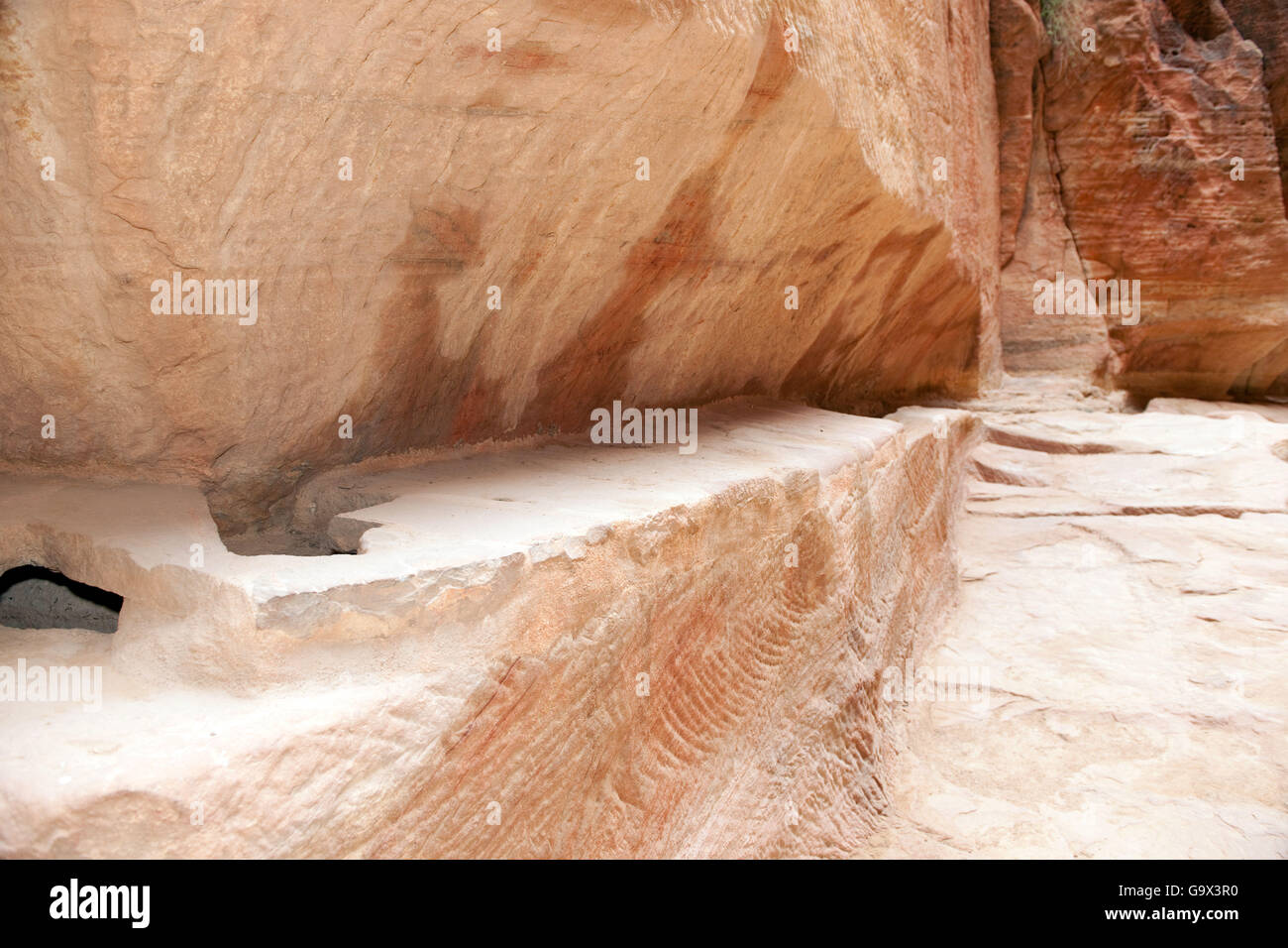 ancient watersupply in canyon, ancient pavestones, Siq of Petra, canyon of Petra Archaeological Park, Petra, Jordan, Stock Photo