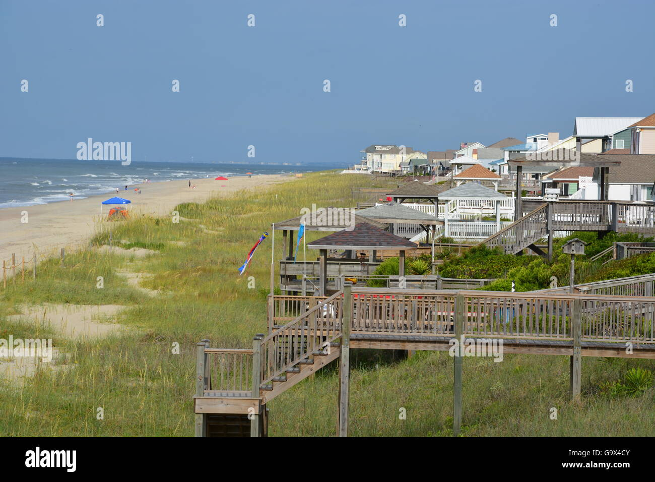 The beach is largely deserted early in the morning at Long Beach, Oak Island in North Carolina - Stock Image