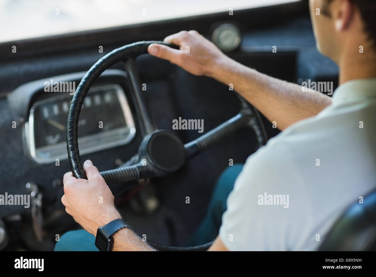 Bus driver driving a bus - Stock Image