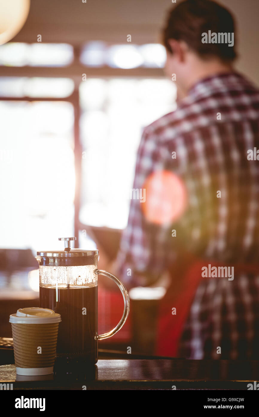 French press and cup of coffee - Stock Image