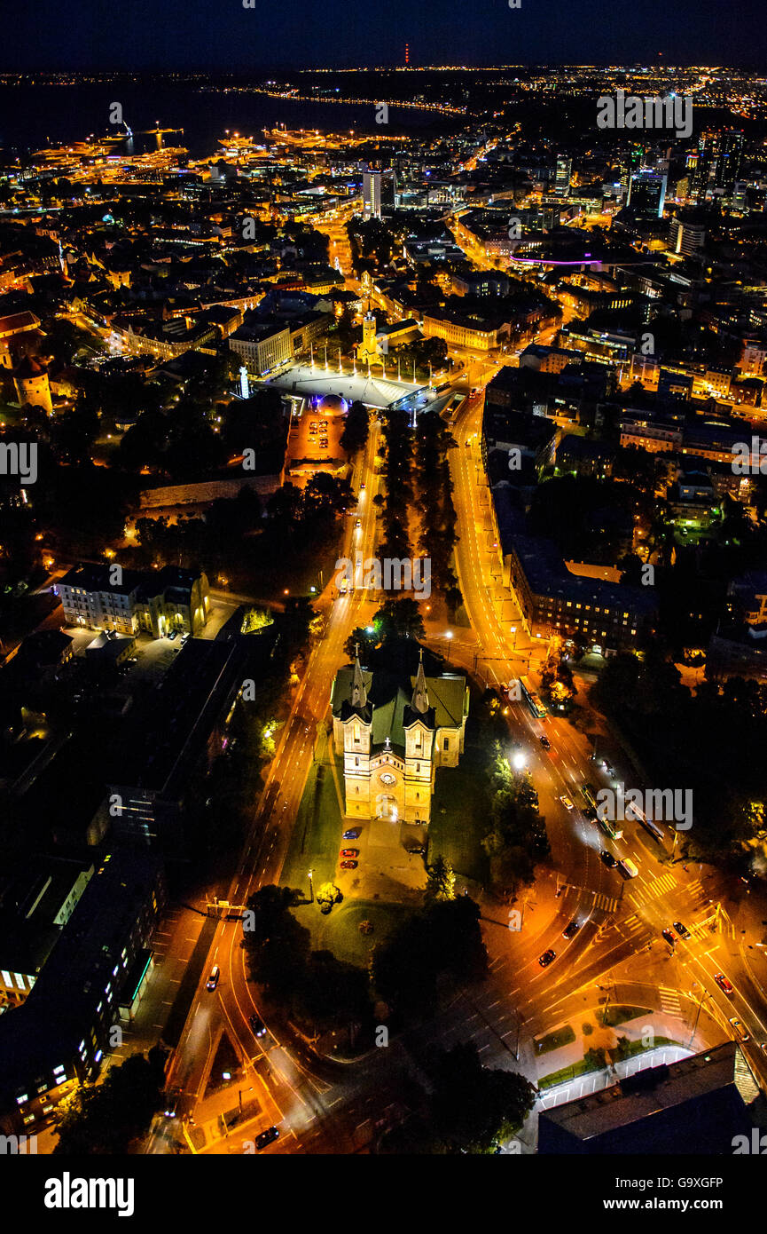 Aerial view of Tallinn, the Capital of Estonia at night, with Charles' Church in the foreground, Estonia, October - Stock Image