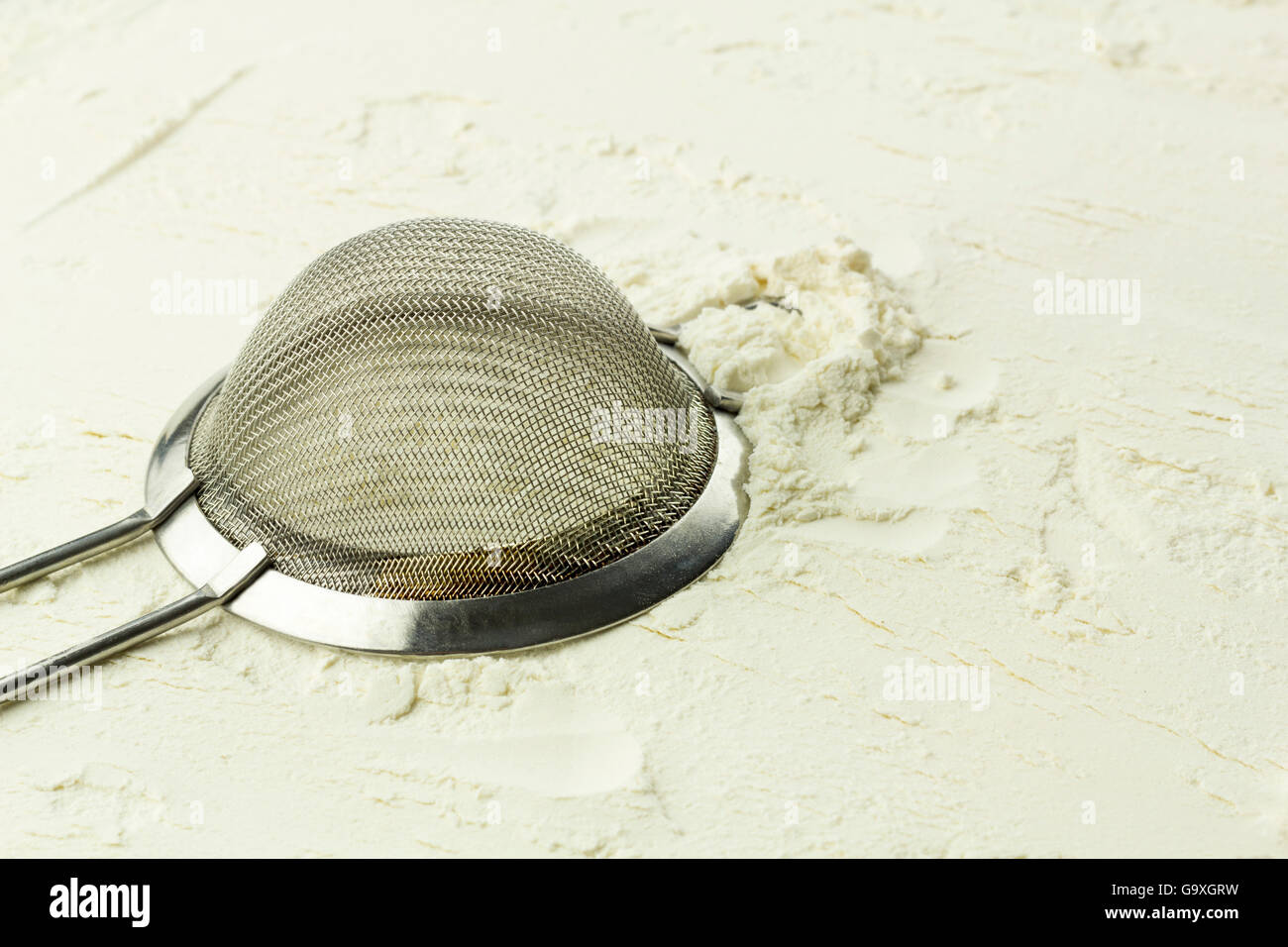 Sifter on the white flour. - Stock Image
