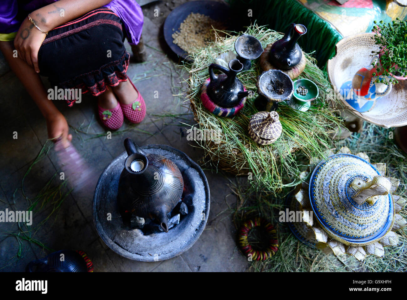 Woman preparing traditional Ethiopian coffee. Lalibela. Ethiopia, December 2014. - Stock Image