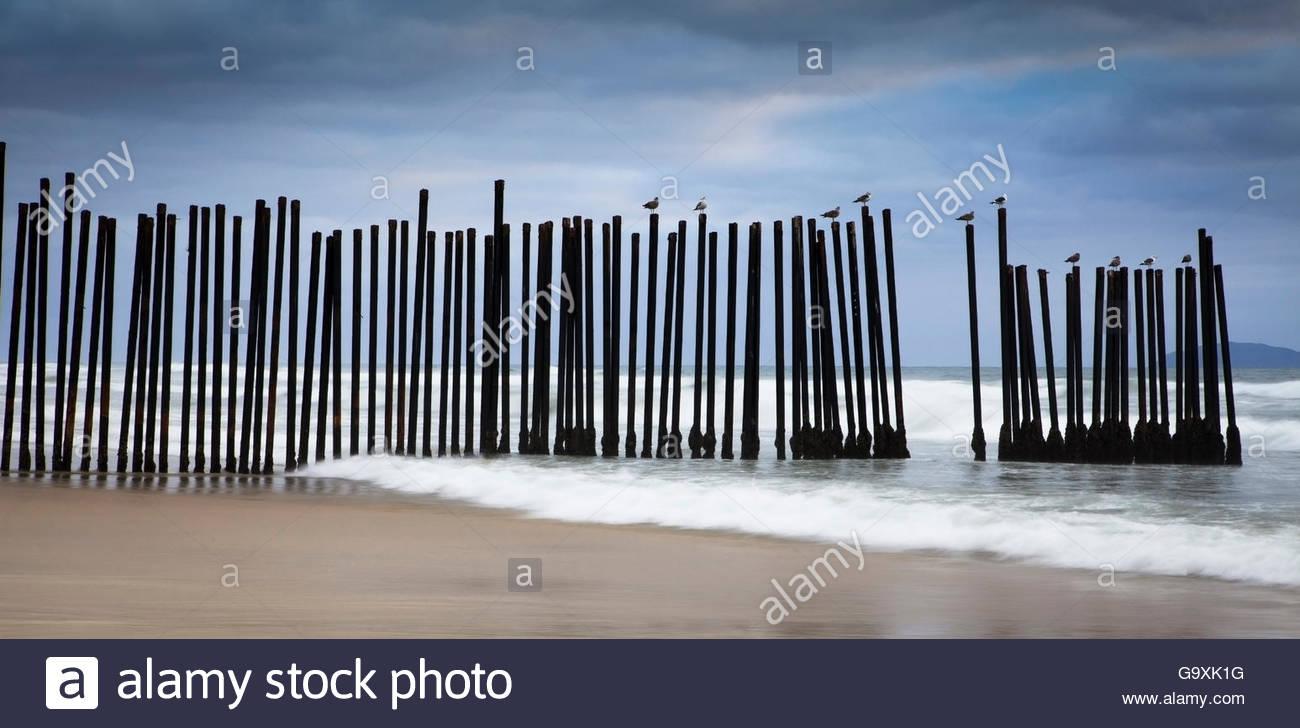 The US-Mexico border wall Pacific Coast, separating Tijuana From San Diego. California, USA. February 2011. - Stock Image