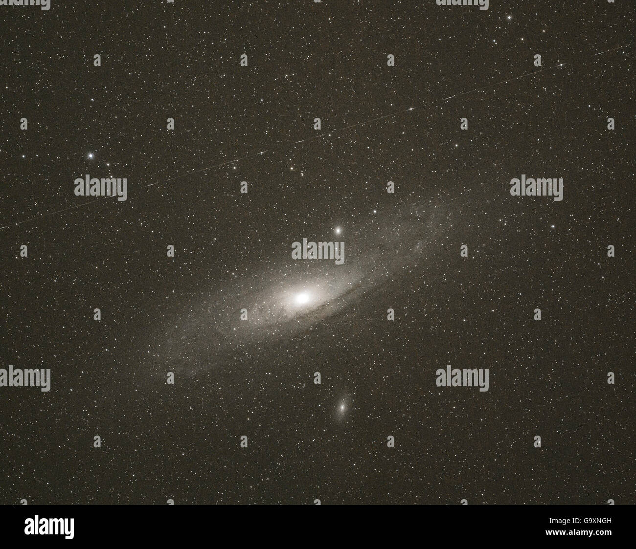Andromeda Galaxy ( Messier 31 / M32) , seen from Villers Le Sec observatory, France, July. - Stock Image