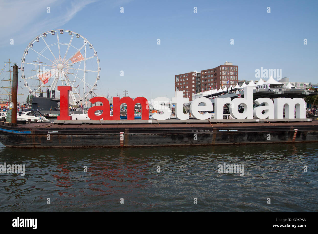 AMSTERDAM, THE NETHERLANDS, 20 AUGUST 2015  Big red and white letters of Amsterdam on a boat during  great nautical - Stock Image