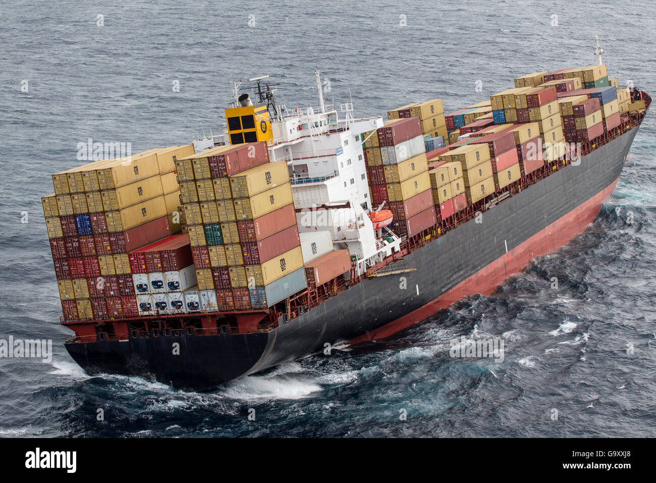 Container ship, MV Rena, approximately 14 hours after becoming grounded on Astrolabe Reef, off of the Port of Tauranga, - Stock Image