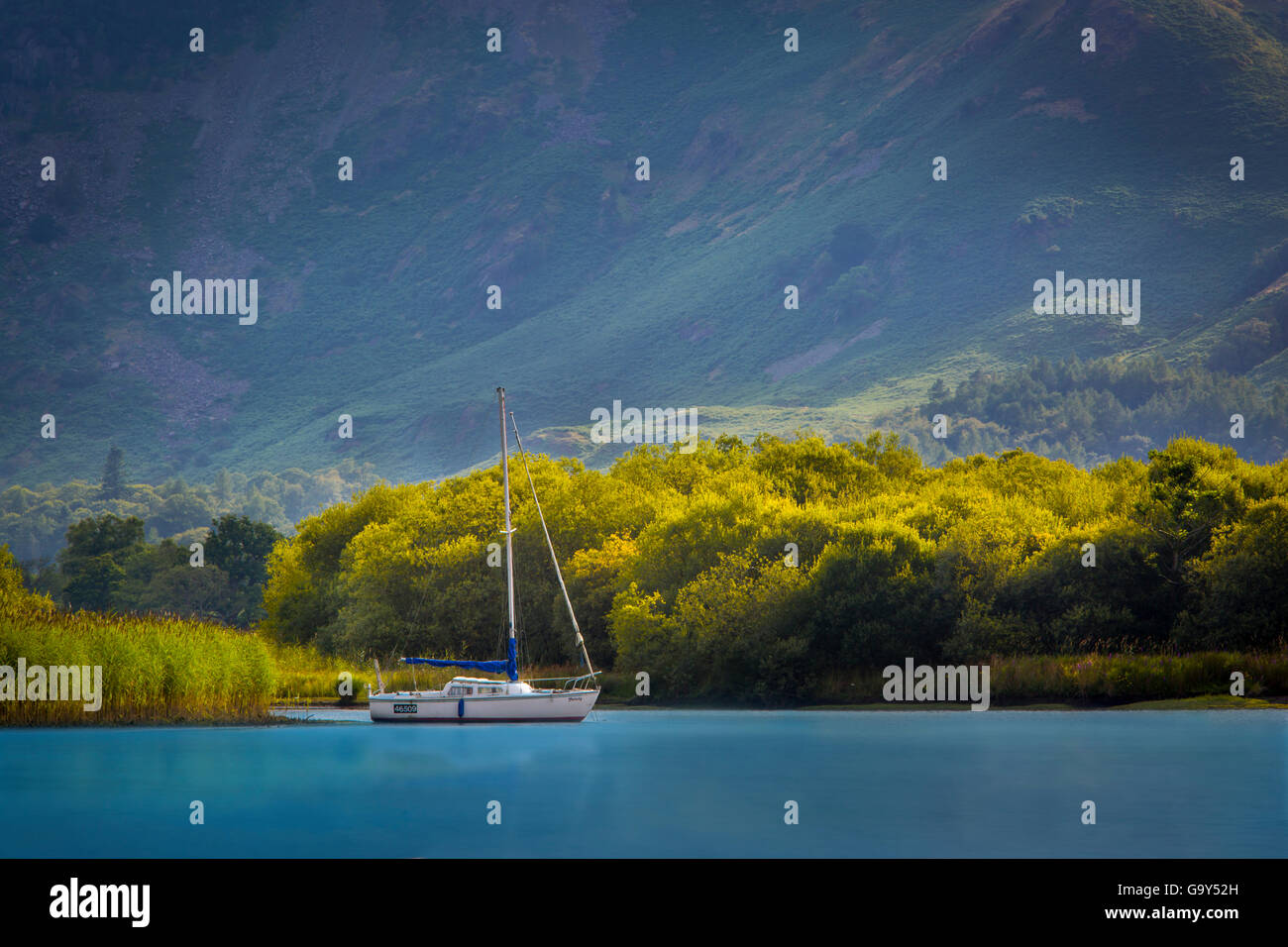 Evening light over sailboat on Derwentwater, the Lake District, Cumbria, England - Stock Image