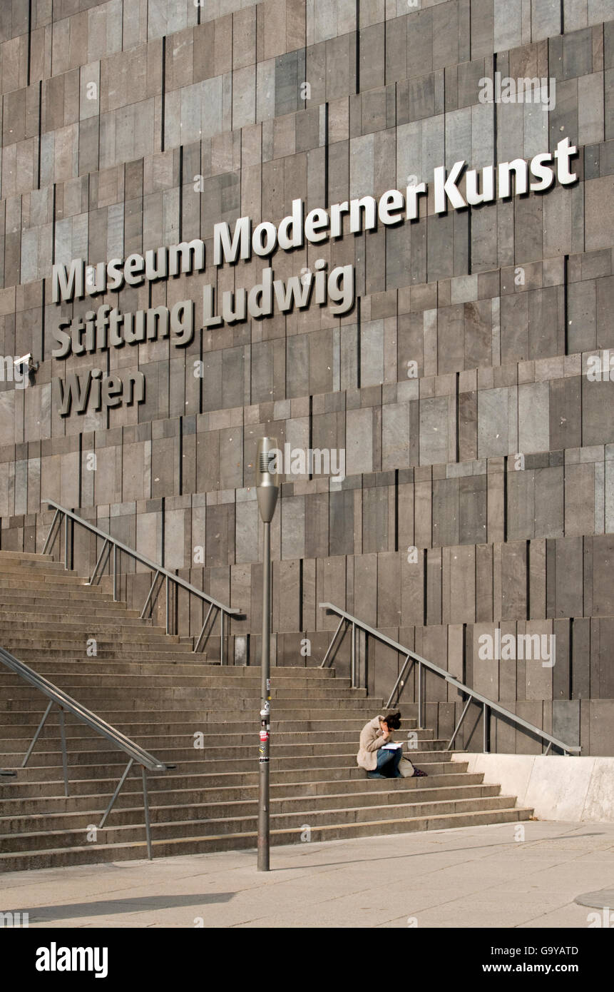 Woman on stairs outside MUMOK, Museum Moderner Kunst or Museum of Modern Art building at MuseumsQuartier in Vienna, - Stock Image