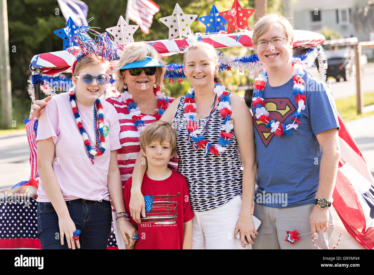A group of residents pose for a photo in front of their decorated golf cart during the Sullivan's Island Independence - Stock Image