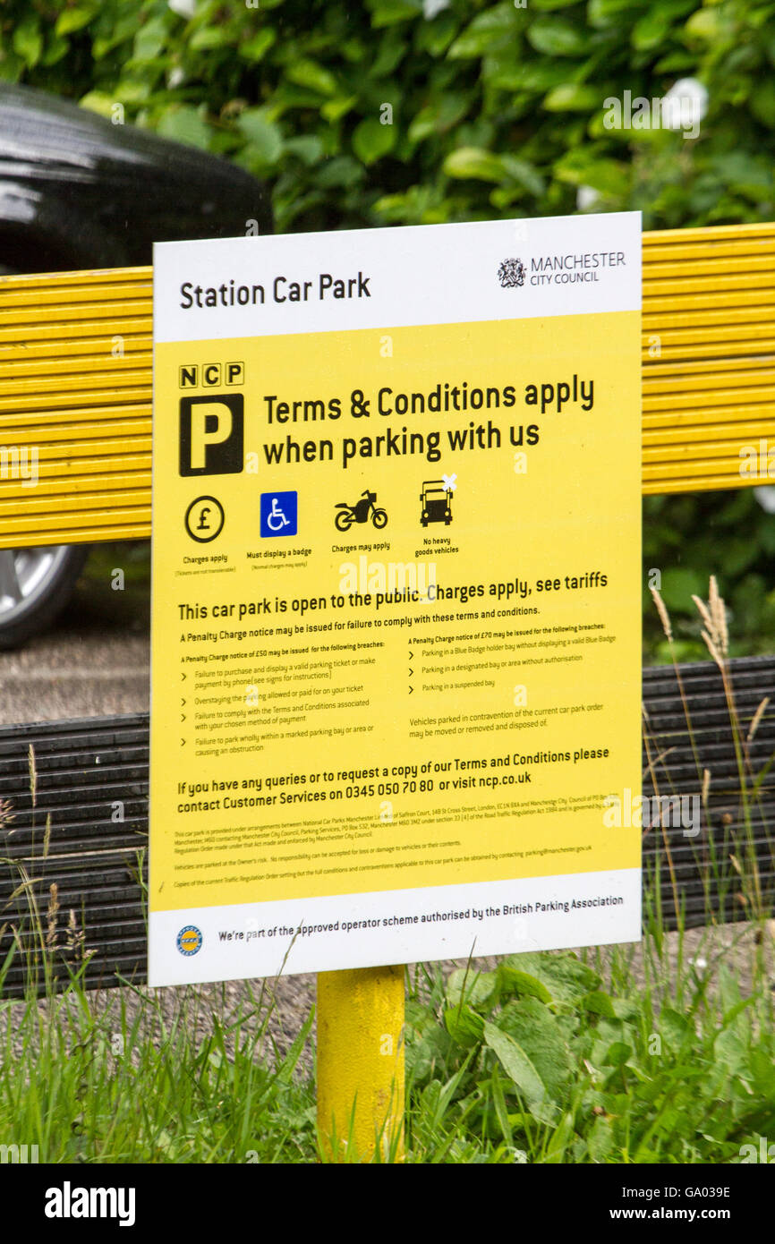 Tellow sign showing terms and conditions at station NCP car park owned by Manchester City Council. - Stock Image