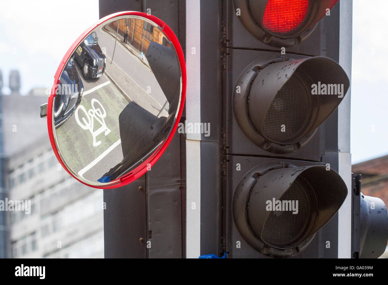 Cyclists mirror at traffic lights to give nearside vision for high-sided vehicles, Manchester, UK - Stock Image