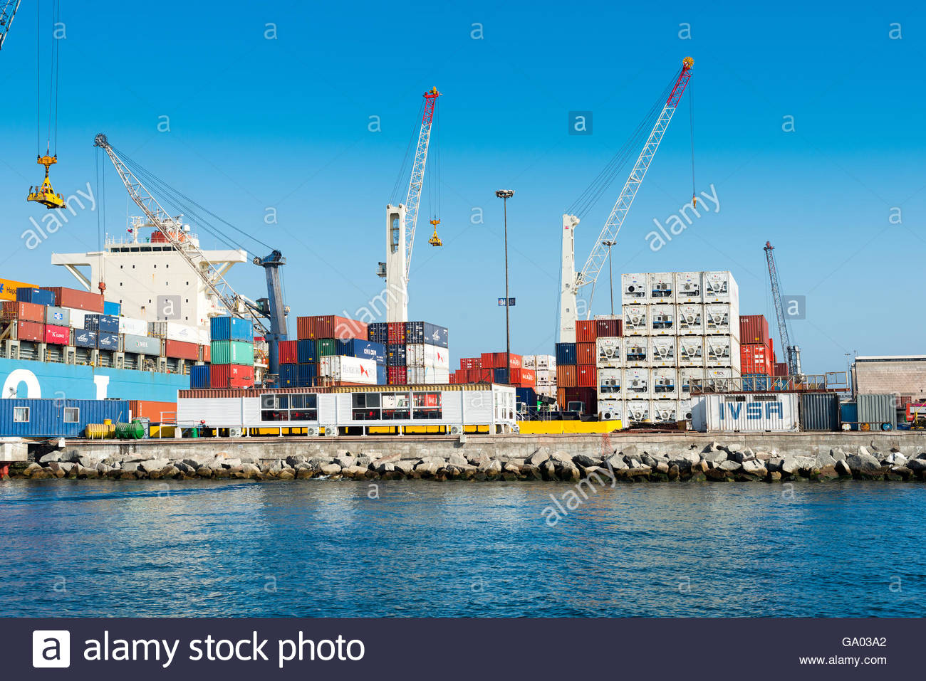 Big cargo ship at international port of Iquique in northern Chile - Stock Image