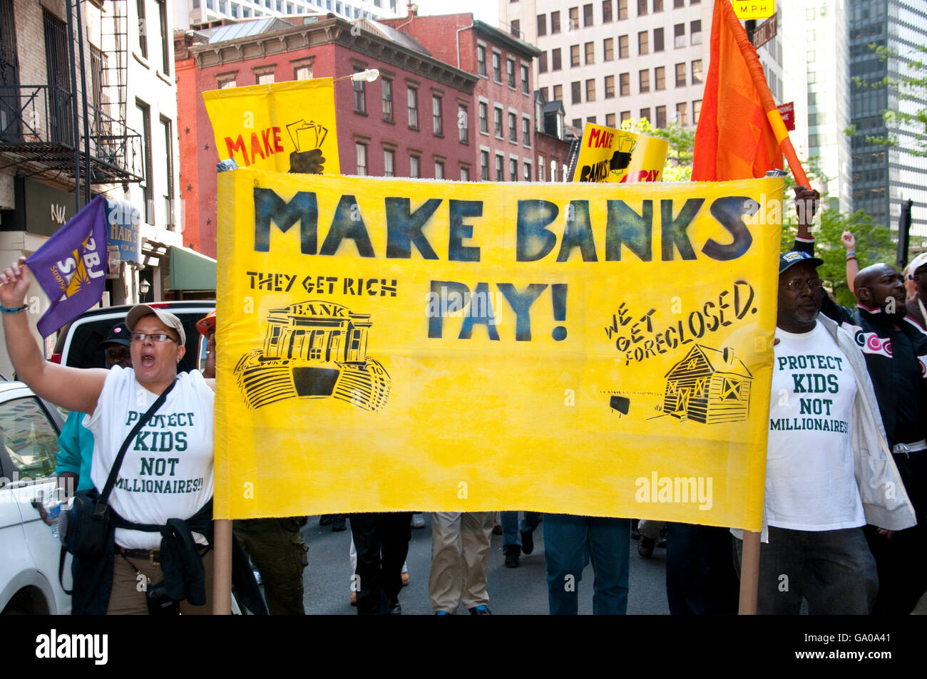 Make banks pay, protest against big banks, war, racial discrimination and in favor of more money for education, - Stock Image