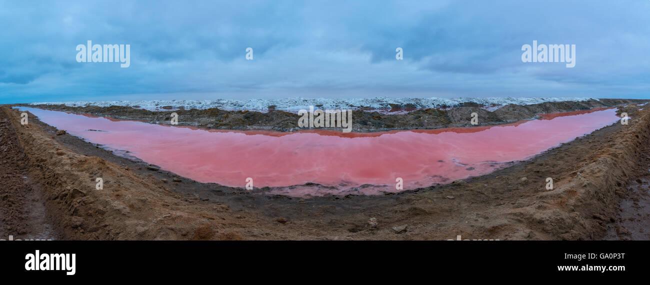 Pink water in saltwater lagoon, Walvis Bay, Namibia, June 2015. - Stock Image