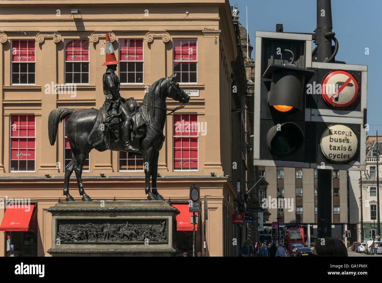 Statue of Duke of Wellington with traffic cone on head, Royal Exchange Square, Glasgow, Scotland, UK, - Stock Image