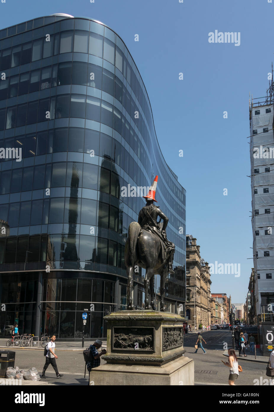 Statue of Duke of Wellington with traffic cone on head,and view down Ingram Street, Glasgow, Scotland, UK, - Stock Image