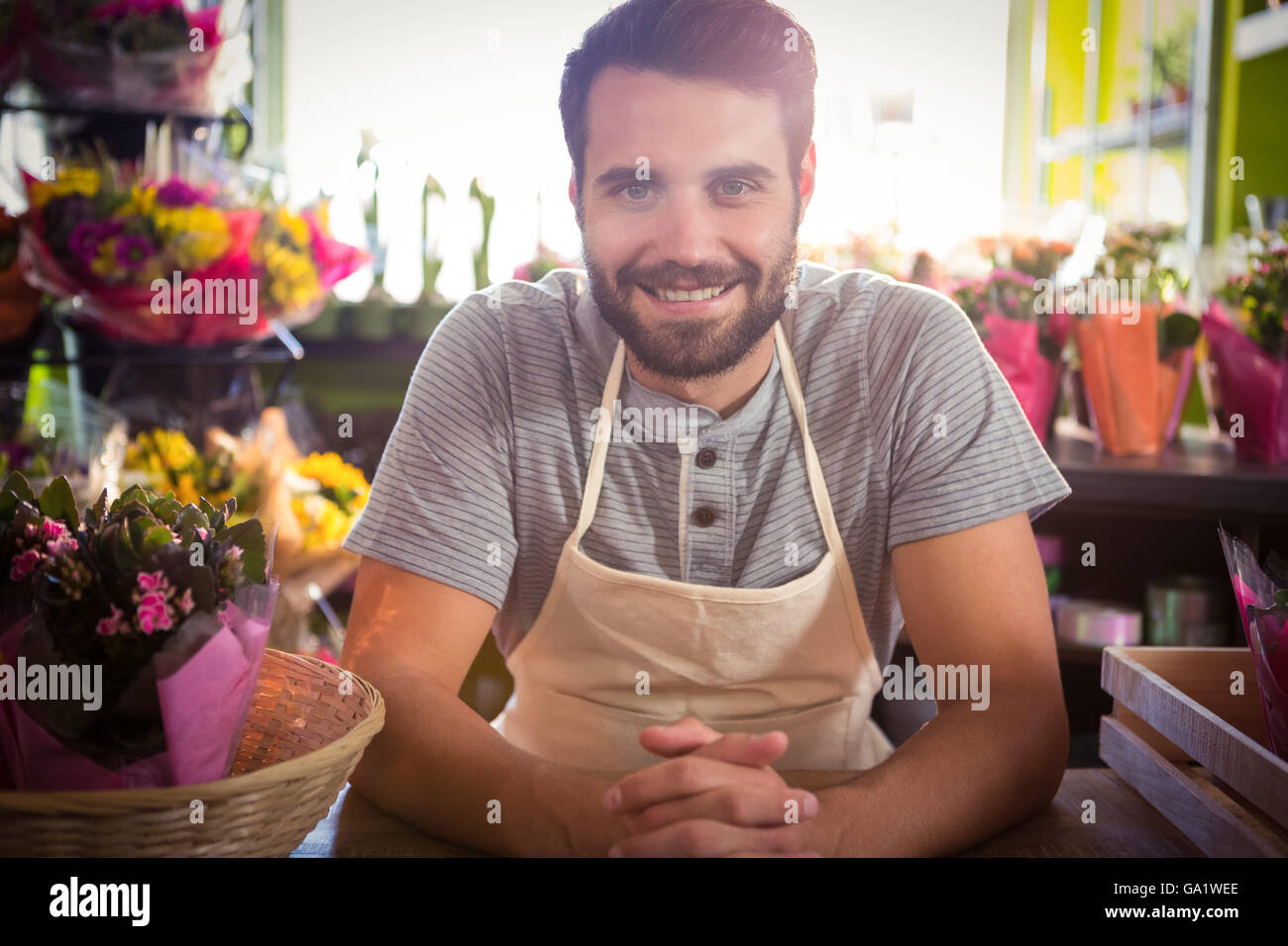 Male florist at his flower shop - Stock Image