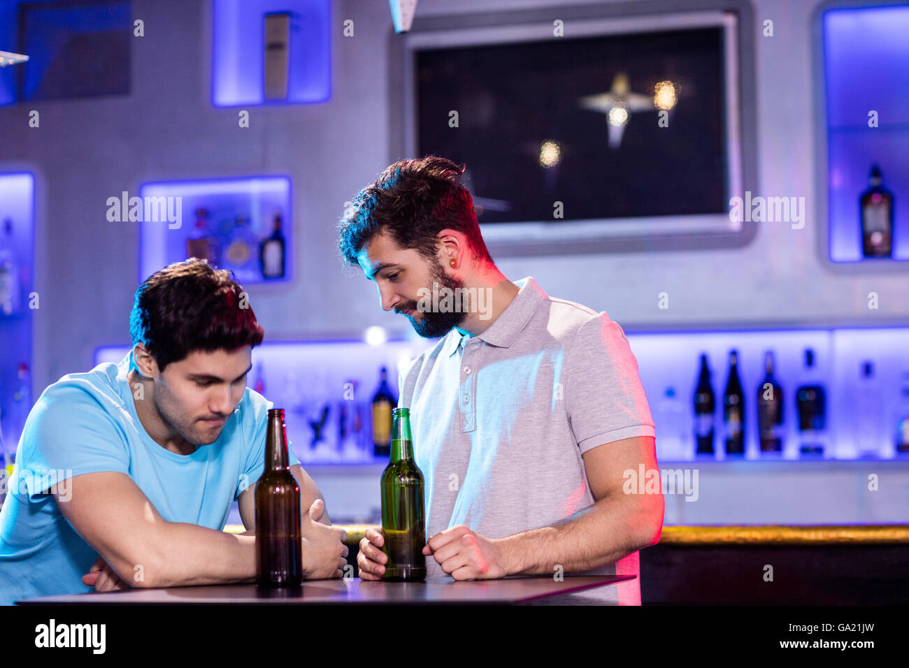 Man consoling his depressed friend - Stock Image