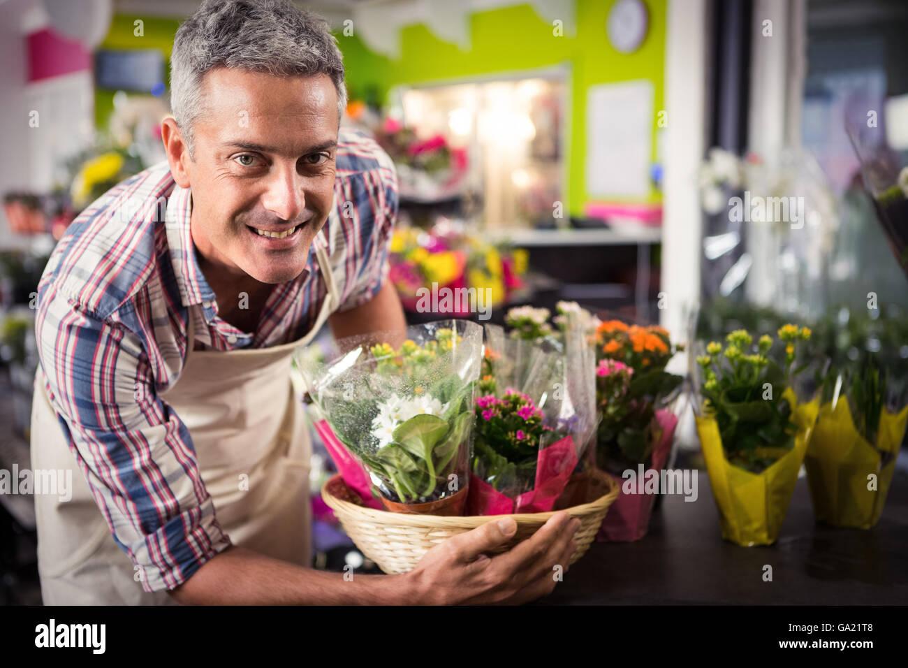 Male florist arranging bouquet of flower - Stock Image