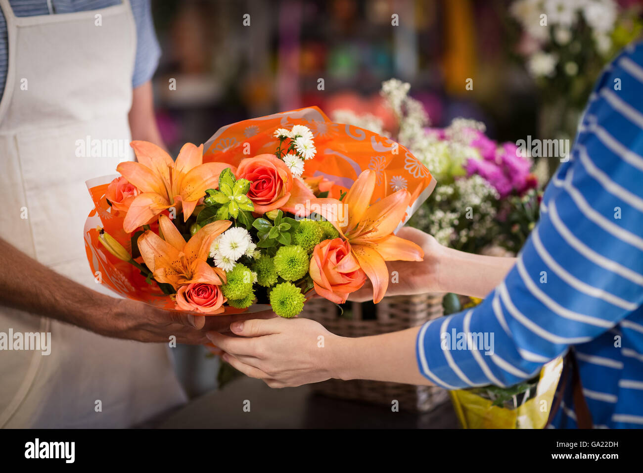 Florist giving bouquet of flower to customer - Stock Image