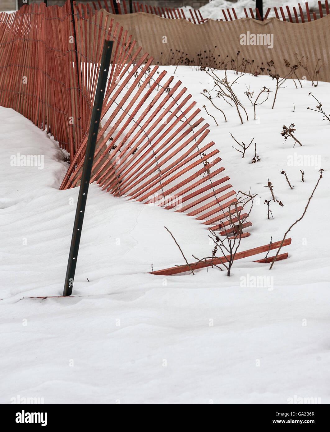 Broken snow fence - Stock Image