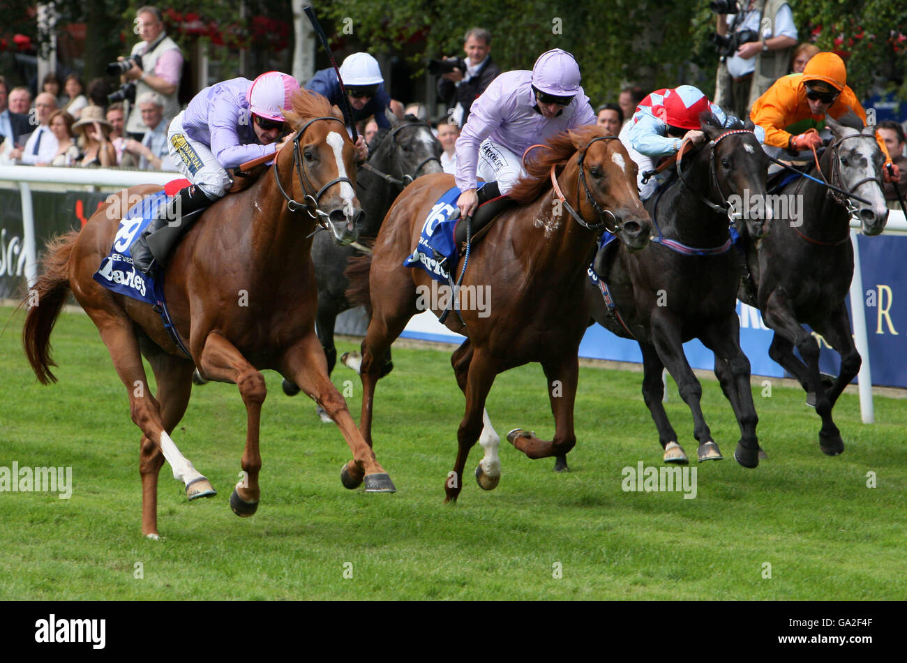 Sakhees Secret [1st left] and Jockey Steve Drowne win the Darley July Cup alongside Dutch Art and Jockey Jimmy Fortune Stock Photo