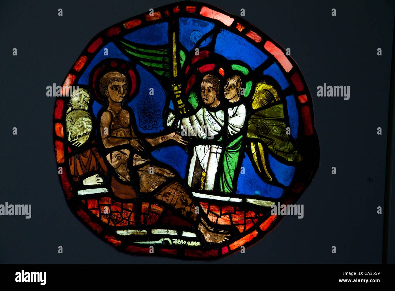 St Vincent Consoled by Angels, 13th century french stained glass, Ely Cathedral Museum of Stained Glass, Cambridgeshire - Stock Image