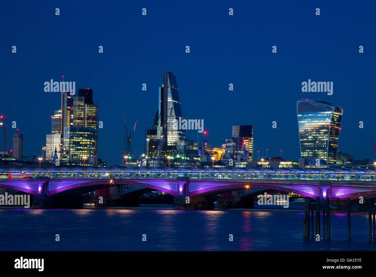 Blackfriars Bridge and River Thames at dusk, taken from South Bank, with Walkie-talkie, Cheesegrater and City of - Stock Image