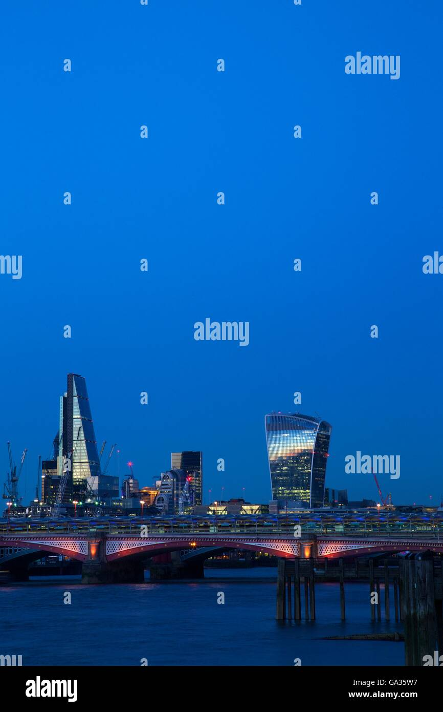 Walkie-talkie, Cheesegrater  Blackfriars Bridge and River Thames at dusk, taken from South Bank - Stock Image