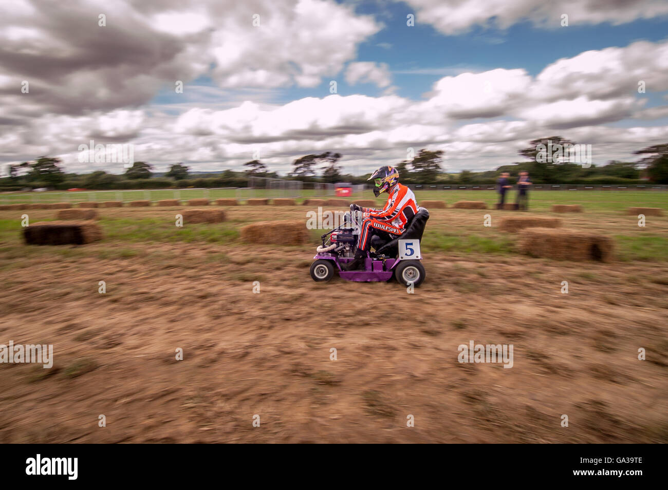 The annual 12-hour lawnmower race at Brinsbury Agricultural College in southern England. - Stock Image