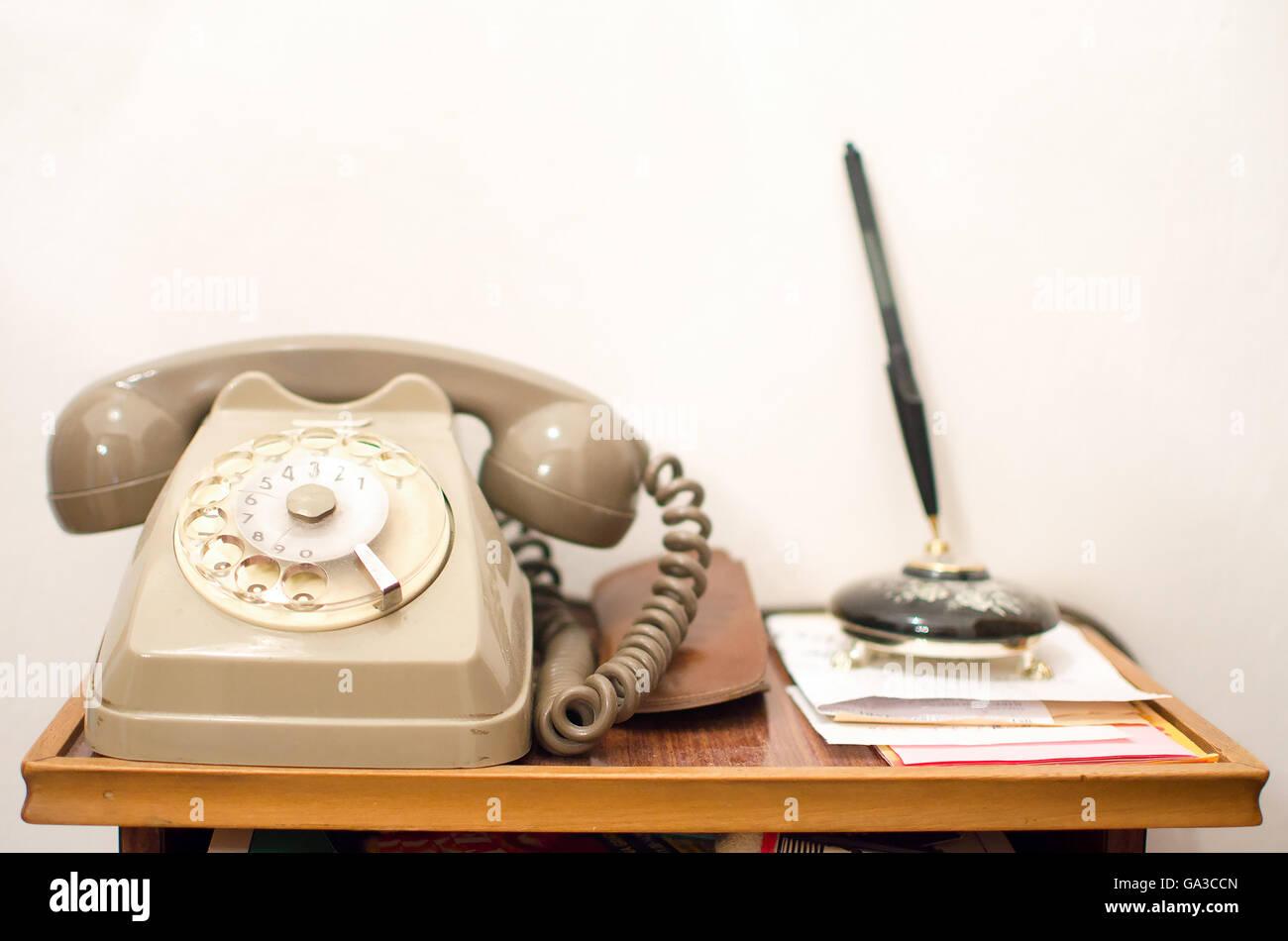 vintage gray telephone handset old little desk - Stock Image