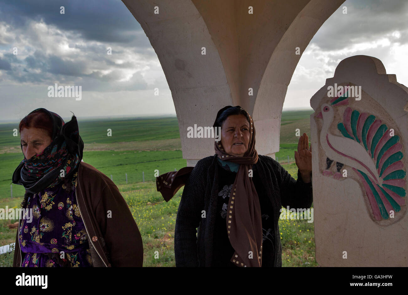 women who weeps in cemetery of Mezra Ezidiye Village.Yazidis are an ethno-religious group indigenous to northern - Stock Image