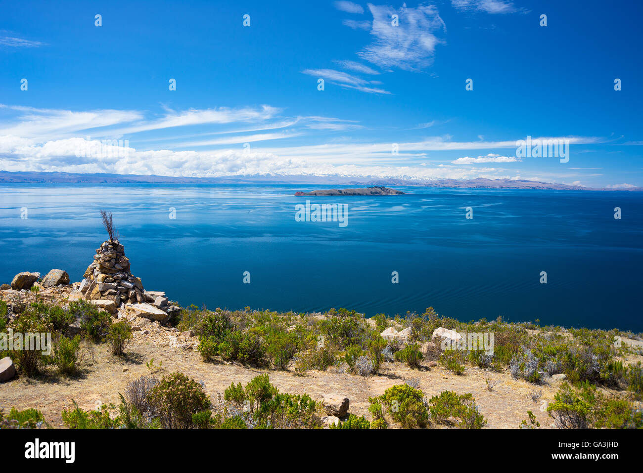Wide angle view from offshore of the Island of the Moon, Titicaca Lake, among the most scenic travel destination - Stock Image