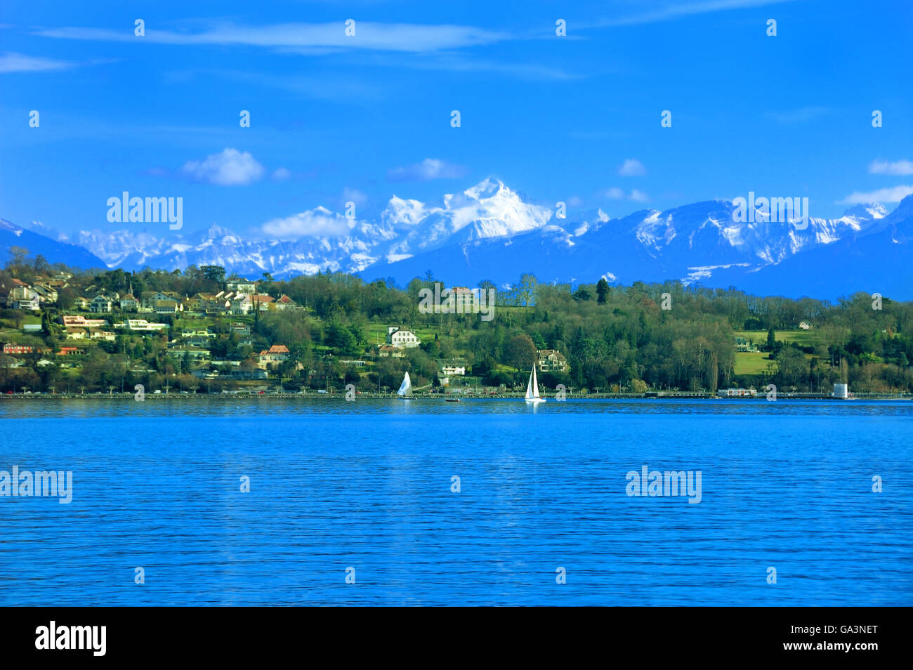 Mount Blanc and the French Alps and a summer day on Lake Geneva. Stock Photo