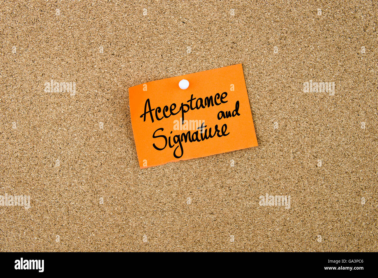 Acceptance and Signature written on orange paper note note pinned on cork board with white thumbtack, copy space - Stock Image