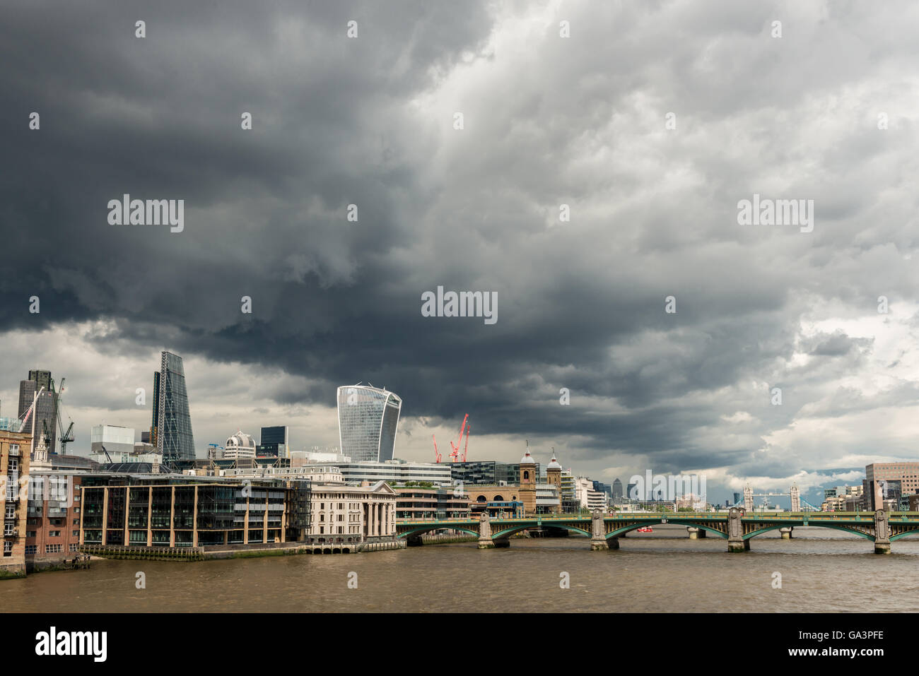 London, United Kingdom - June 25, 2016: London Skyline with moody sky seconds before a storm, with Southwark bridge - Stock Image