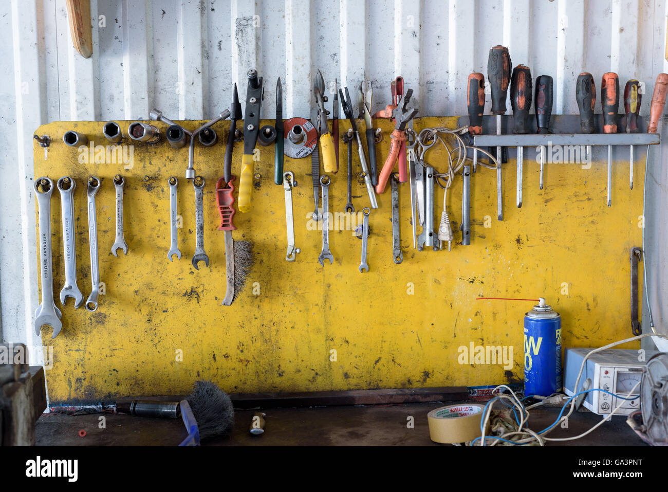 Display of garage work tools on a workbench with nobody - Stock Image