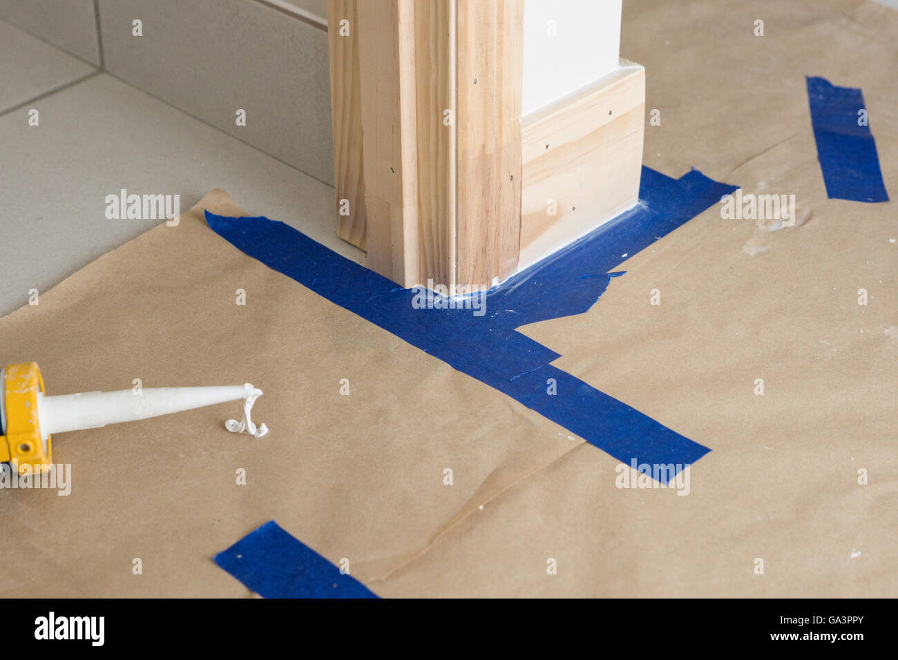 Masking and filling gaps before painting new house - Stock Image