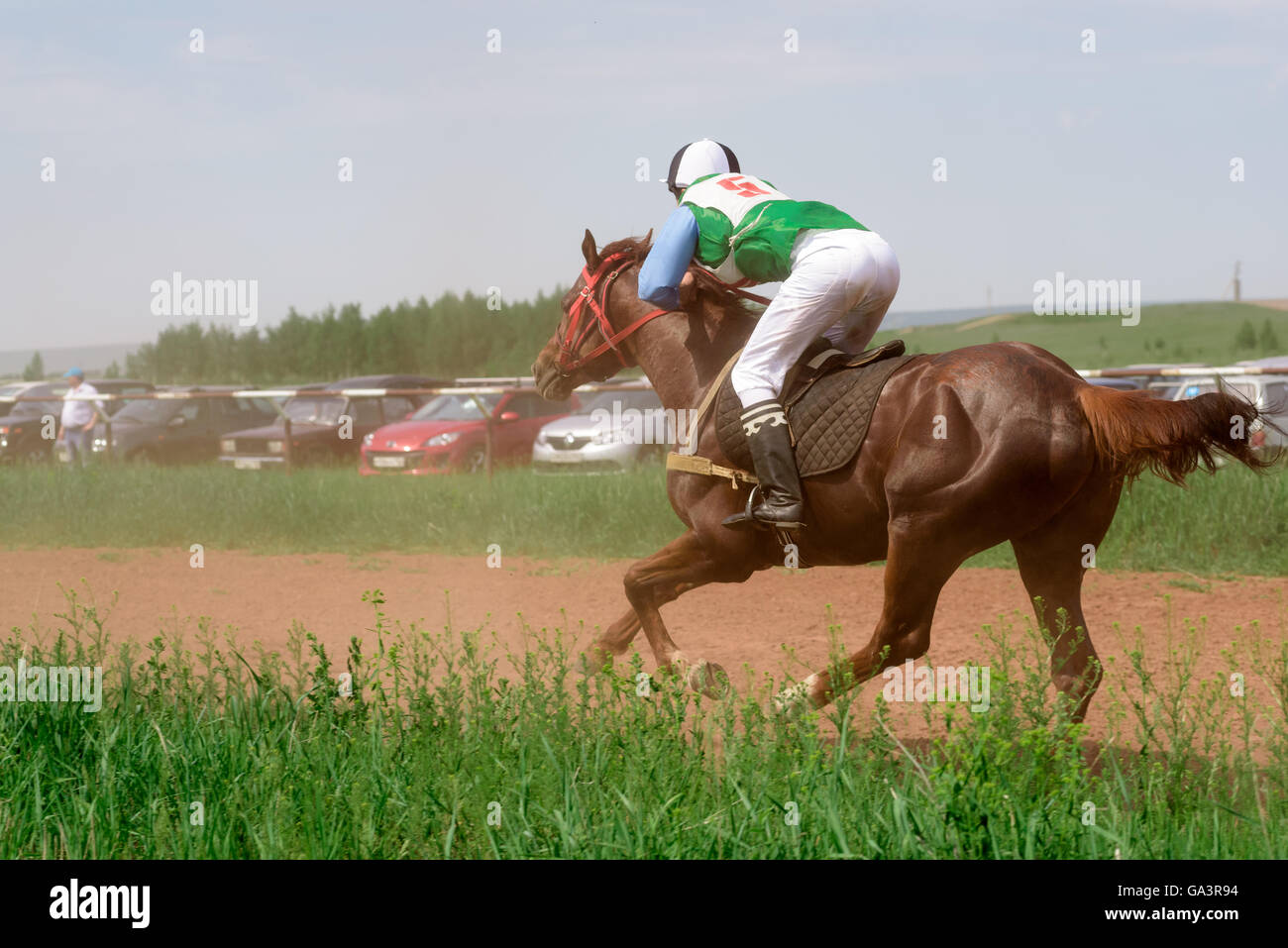 Galloping Horses And Their Riders At A Horse Racing Event In Summer